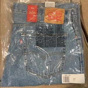 Levis 505 regular fit straight leg jeans 38x32